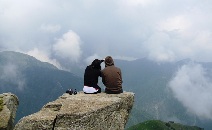 Volunteers-are-sitting-on-a-rock-in-Palampur