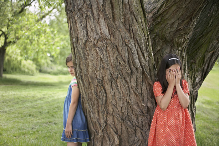 Two Girls Playing Hide-and-Seek