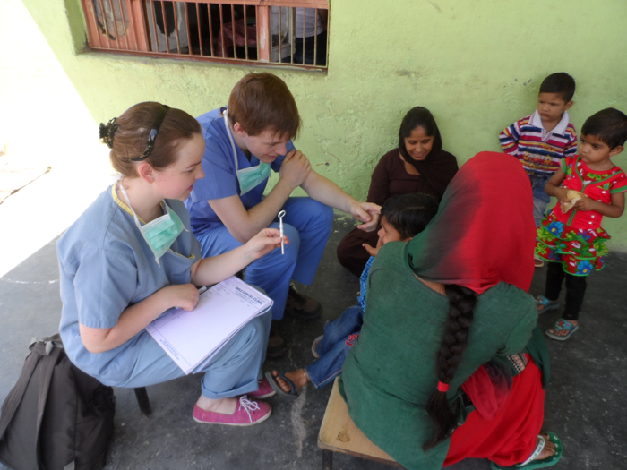 Dental intern while examining the kids